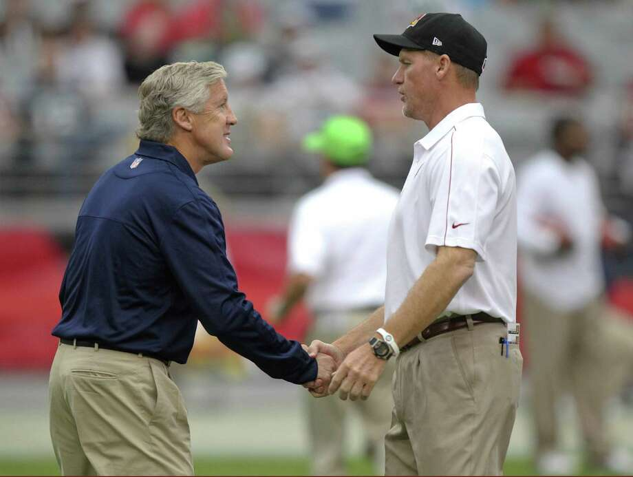 Seattle Seahawks head coach Pete Carroll, left, greets Arizona Cardinals head coach Ken Whisenhunt prior to an NFL football game, Sunday, Sept. 9, 2012,in Glendale, Ariz. Photo: AP