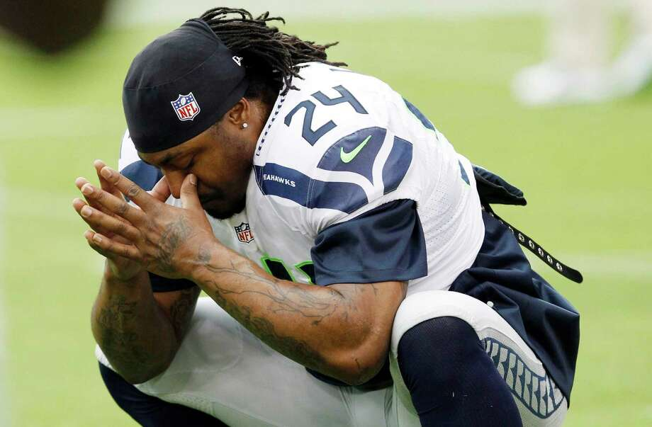 Seattle Seahawks' Marshawn Lynch pauses while warming up prior to an NFL football game against the Arizona Cardinals Sunday, Sept. 9, 2012, in Glendale, Ariz. Photo: AP