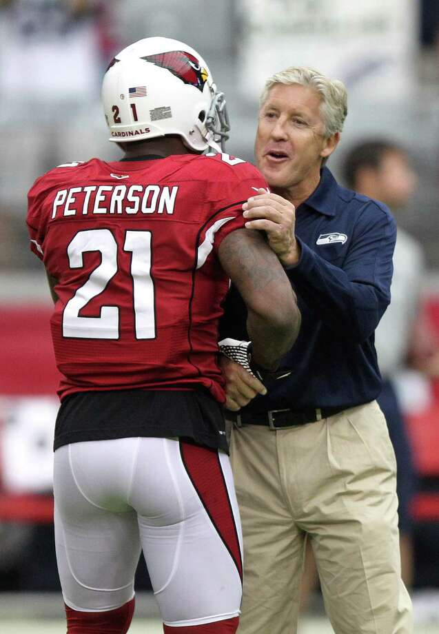 Seattle Seahawks head coach Pete Carroll greets Arizona Cardinals cornerback Patrick Peterson (21) prior to an NFL football game, Sunday, Sept. 9, 2012,in Glendale, Ariz. Photo: AP