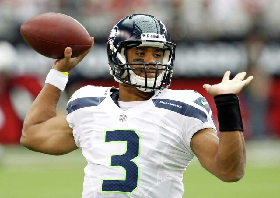 Seattle Seahawks' Russell Wilson throws a pass as he warms up prior to an NFL football game against the Arizona Cardinals, Sunday, Sept. 9, 2012, in Glendale, Ariz. Photo: AP