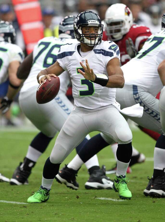 Seattle Seahawks quarterback Russell Wilson (3) drops back to pass against the Arizona Cardinals during the first half of an NFL football game, Sunday, Sept. 9, 2012,in Glendale, Ariz. Photo: AP