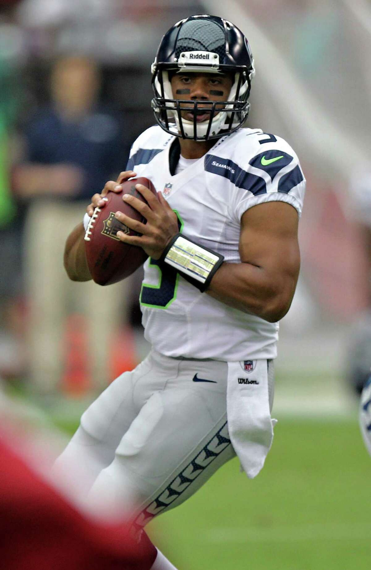 Seattle Seahawks quarterback Russell Wilson (3) drops back to pass against the Arizona Cardinals during the first half of an NFL football game, Sunday, Sept. 9, 2012,in Glendale, Ariz.