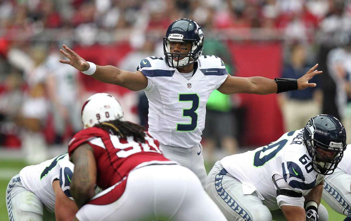 Seattle Seahawks quarterback Russell Wilson (3) calls a play against the Arizona Cardinals during the first half of an NFL football game, Sunday, Sept. 9, 2012,in Glendale, Ariz.