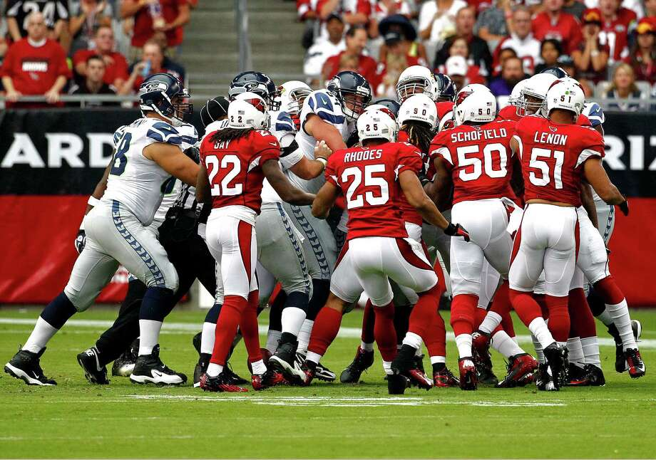 The Arizona Cardinals and the Seattle Seahawks start to fight after a play during the first half of an NFL football game, Sunday, Sept. 9, 2012,in Glendale, Ariz. Photo: AP