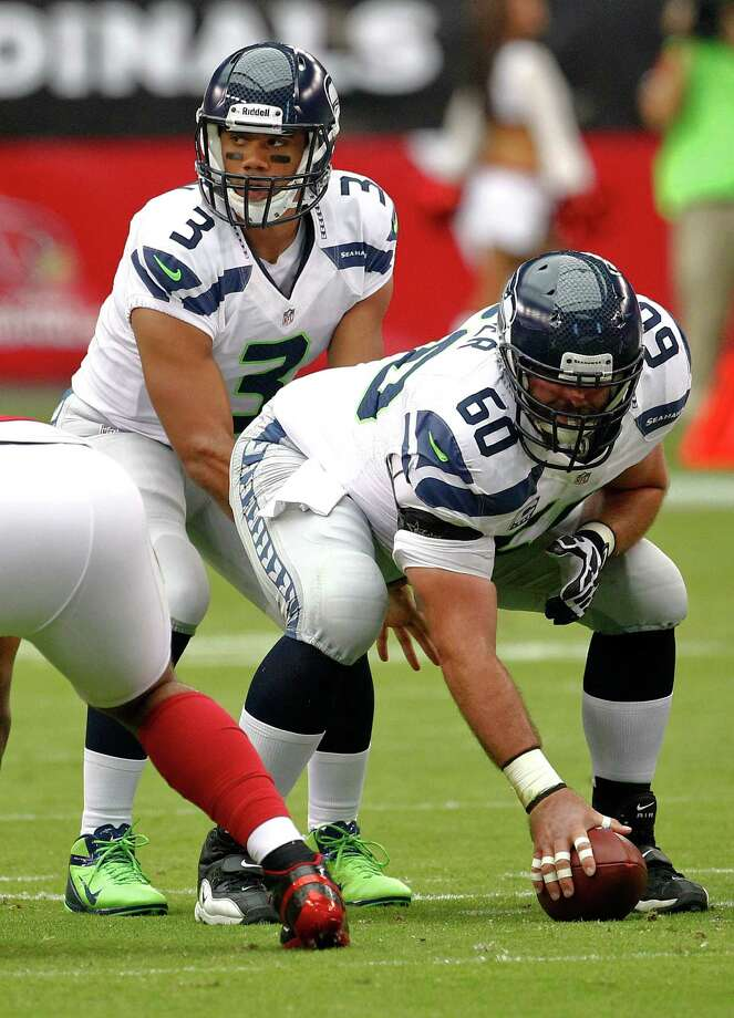 Seattle Seahawks quarterback Russell Wilson (3) lines up under center  Max Unger (60) during the first half of an NFL football game against the Arizona Cardinals, Sunday, Sept. 9, 2012,in Glendale, Ariz. Photo: AP