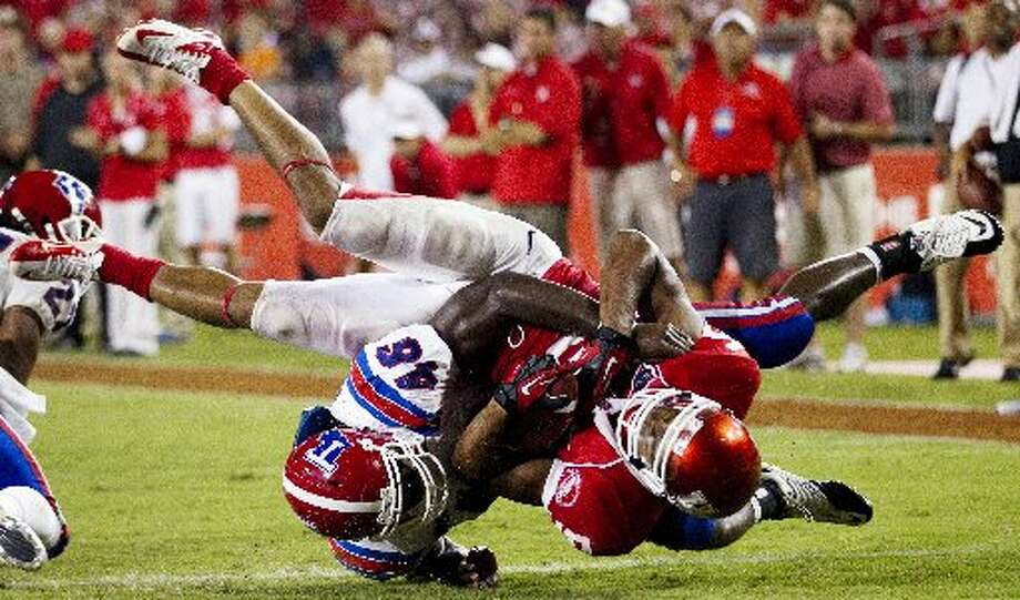12. Houston (Last week 12, next week at UCLA) – Cougars and Louisiana Tech combine for NCAA  records for plays, pass without  interceptions, completions and first downs. But the Cougars' defense is more porous than the offense is productive as they stumble to first 0-2 start since 2004. Brett Coomer/Houston Chronicle