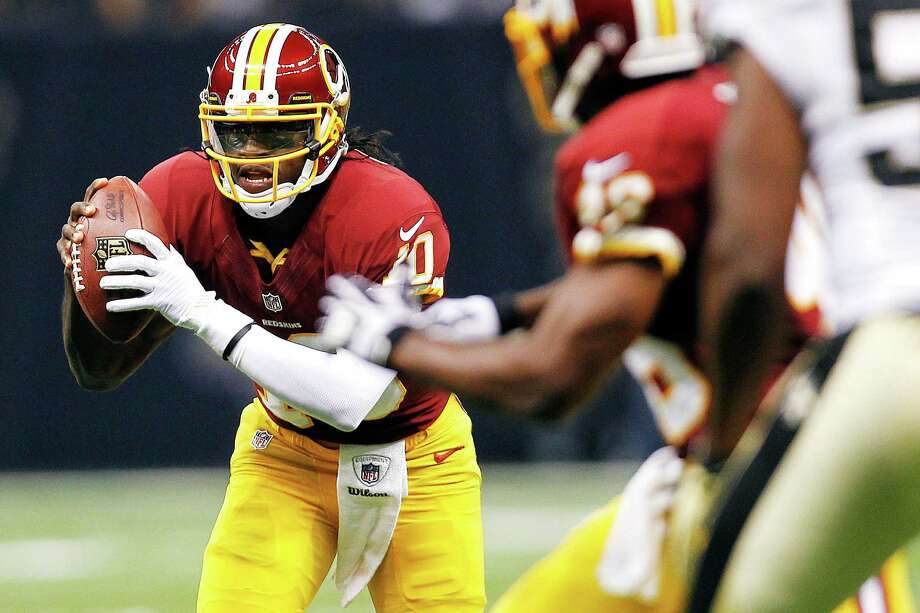 Washington Redskins quarterback Robert Griffin III (10) scrambles in the first half of an NFL football game against the New Orleans Saints in New Orleans, Sunday, Sept. 9, 2012. (AP Photo/Gerald Herbert) Photo: Gerald Herbert / AP