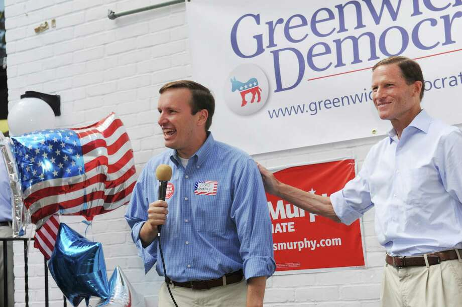 U.S Senator Richard Blumenthal, introduces Chris Murphy, running for Senate in Connecticut at Greenwich Democratic Town Committee annual picinic at the Garden Education Center Sunday, Sept. 9, 2012. Photo: Helen Neafsey / Greenwich Time