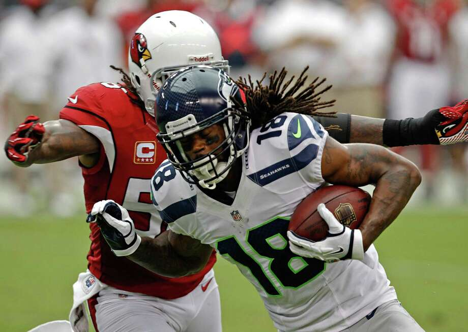 Seattle Seahawks wide receiver Sidney Rice (18) is tackled by Arizona Cardinals linebacker Reggie Walker during the first half of their NFL football game, Sunday, Sept. 9, 2012, in Glendale, Ariz. Photo: AP