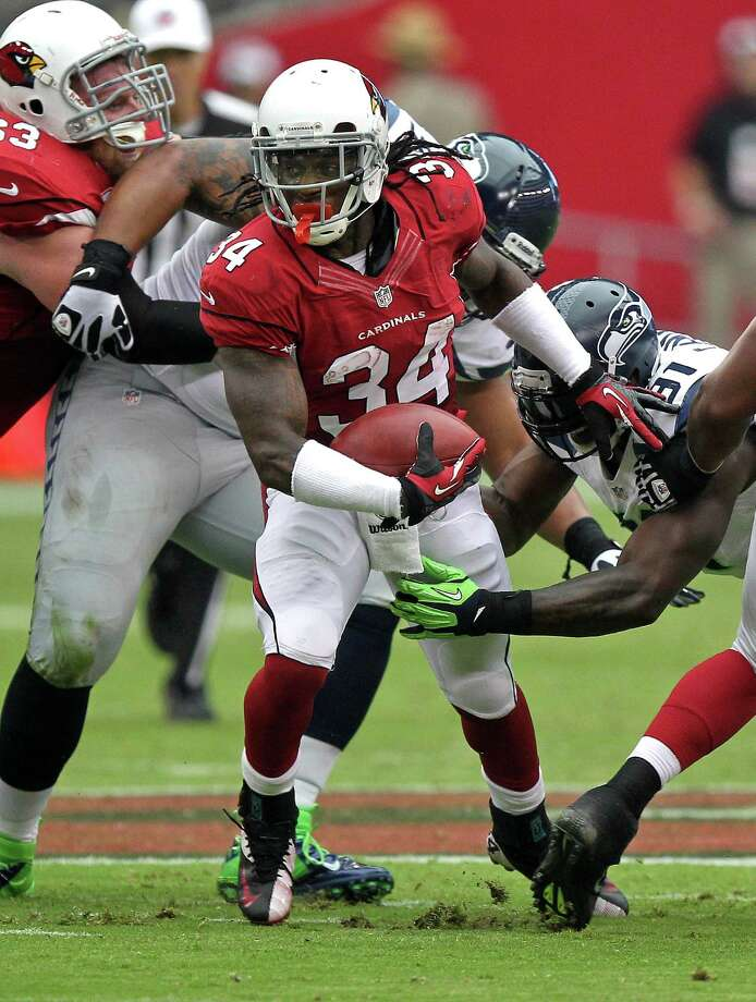 Arizona Cardinals running back Ryan Williams (34) gains yards against the Seattle Seahawks during the first half of their NFL football game, Sunday, Sept. 9, 2012, in Glendale, Ariz. Photo: AP