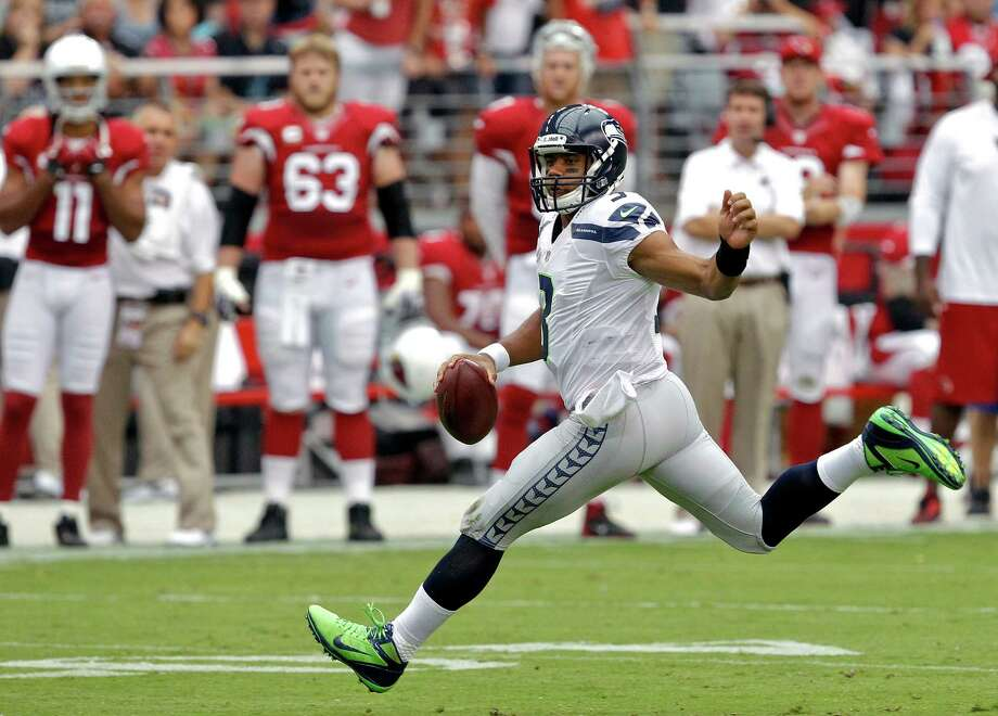 Seattle Seahawks quarterback Russell Wilson scrambles against the Arizona Cardinals during the first half of an NFL football game on Sunday, Sept. 9, 2012,in Glendale, Ariz. Photo: AP
