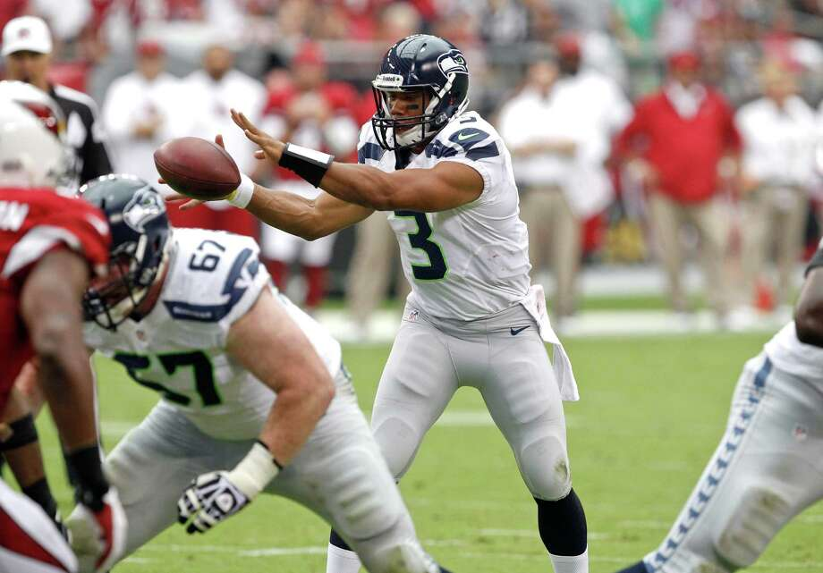 Seattle Seahawks quarterback Russell Wilson (3) takes the snap against the Arizona Cardinals during the first half of an NFL football game, Sunday, Sept. 9, 2012,in Glendale, Ariz. Photo: AP