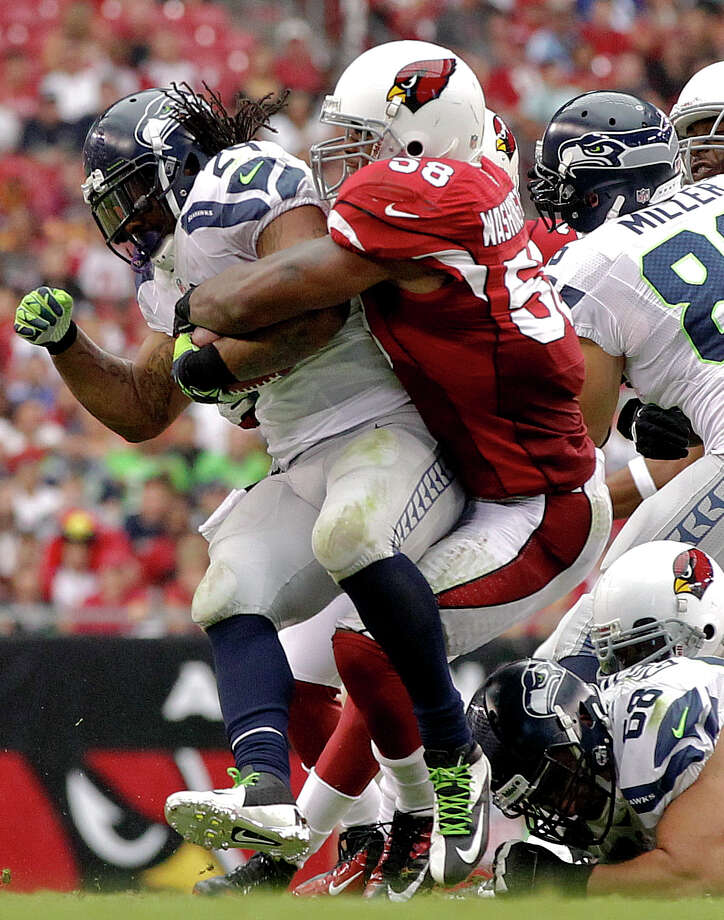 Arizona Cardinals linebacker Daryl Washington (58) stops Seattle Seahawks running back Marshawn Lynch (24) during the first half of an NFL football game, Sunday, Sept. 9, 2012,in Glendale, Ariz. Photo: AP