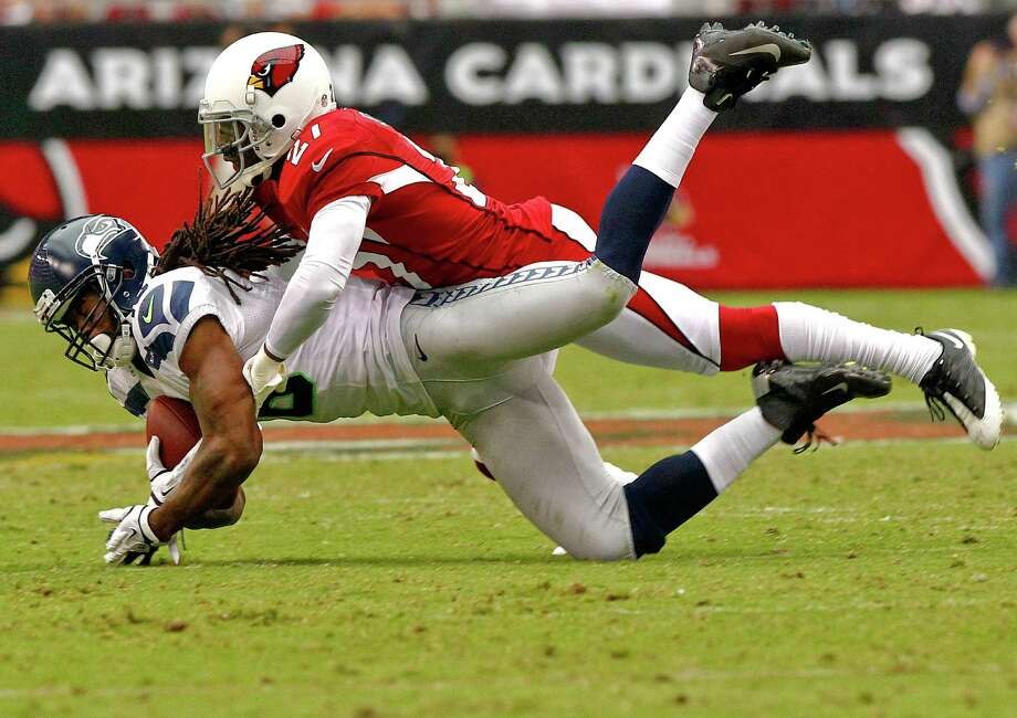 Seattle Seahawks wide receiver Sidney Rice makes the catch as Arizona Cardinals cornerback Patrick Peterson makes the tackle during the first half of an NFL football game, Sunday, Sept. 9, 2012,in Glendale, Ariz. Photo: AP
