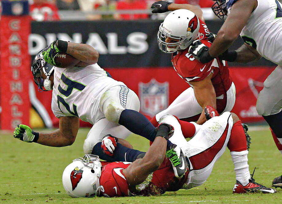 Seattle Seahawks running back Marshawn Lynch (24) is stopped by Arizona Cardinals linebacker Daryl Washington during the first half of an NFL football game, Sunday, Sept. 9, 2012,in Glendale, Ariz. Photo: AP