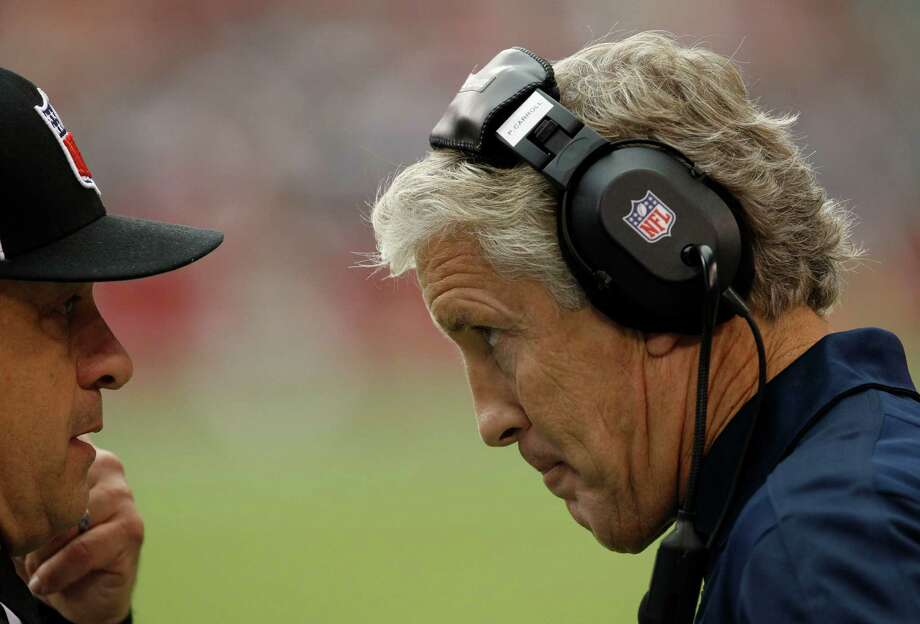 Seattle Seahawks head coach Pete Carroll, right, talks with an official during the first half of their NFL football game against the Arizona Cardinals, Sunday, Sept. 9, 2012, in Glendale, Ariz. Photo: AP