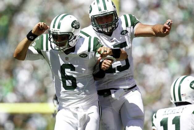 EAST RUTHERFORD, NJ - SEPTEMBER 09:  Mark Sanchez #6 and Tim Tebow #15 of the New York Jets celebrate a touchdown against the Buffalo Bills during their season opener at MetLife Stadium on September 9, 2012 in East Rutherford, New Jersey.  (Photo by Jeff Zelevansky/Getty Images) Photo: Jeff Zelevansky, Getty Images / 2012 Getty Images