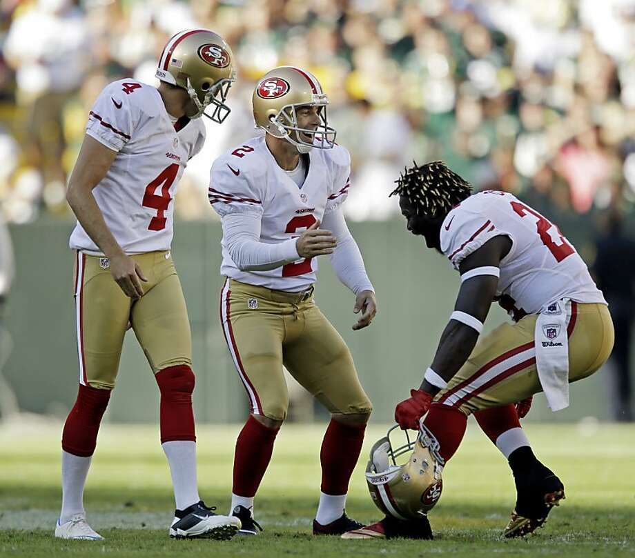 David Akers (3) celebrates with Andy Lee (4) and Anthony Dixon after his 63-yard field goal. Akers tied Tom Dempsey, Jason Elam and Sebastian Janikowski for the longest NFL field goal. Photo: Jeffrey Phelps, Associated Press