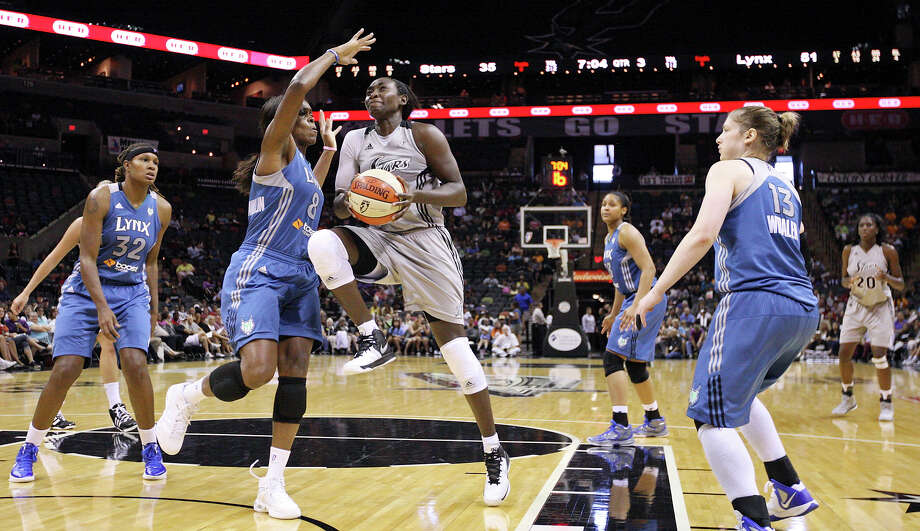 Silver Stars' Sophia Young drives to the basket against Lynx's Taj McWilliams-Franklin during second half action Sunday Sept. 9, 2012 at the AT&T Center.  Young was fouled on the play. The Lynx won 81-62. Photo: Edward A. Ornelas, Express-News / © 2012 San Antonio Express-News