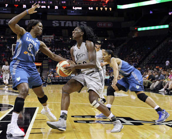 Silver Stars' Shameka Christon (center) looks for room between Lynx's Taj McWilliams-Franklin (left) and Lynx's Maya Moore during first half action Sunday Sept. 9, 2012 at the AT&T Center. Photo: Edward A. Ornelas, Express-News / © 2012 San Antonio Express-News