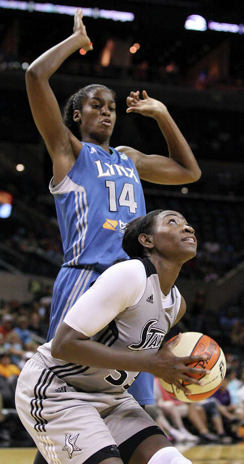 Silver Stars' Sophia Young looks for room under Lynx's Devereaux Peters during second half action Sunday Sept. 9, 2012 at the AT&T Center.  The Lynx won 81-62. Photo: Edward A. Ornelas, Express-News / © 2012 San Antonio Express-News