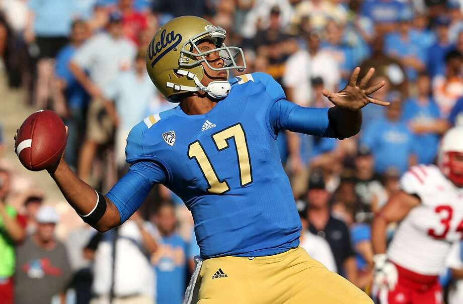 PASADENA, CA - SEPTEMBER 08:  Quarterback Brett Hundley #12 of the UCLA Bruins throws a pass against the Nebraska Cornhuskers at the Rose Bowl on September 8, 2012 in Pasadena, California.  (Photo by Stephen Dunn/Getty Images) Photo: Stephen Dunn, Getty Images