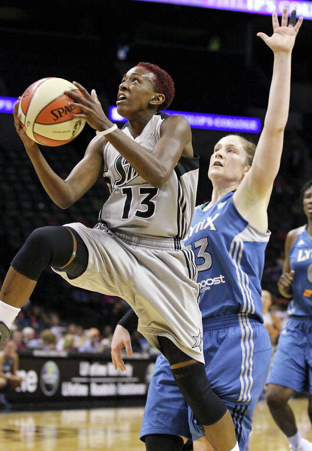 Silver Stars' Danielle Robinson drives to the basket around Lynx's Lindsay Whalen during first half action Sunday Sept. 9, 2012 at the AT&T Center. Photo: Edward A. Ornelas, Express-News / © 2012 San Antonio Express-News