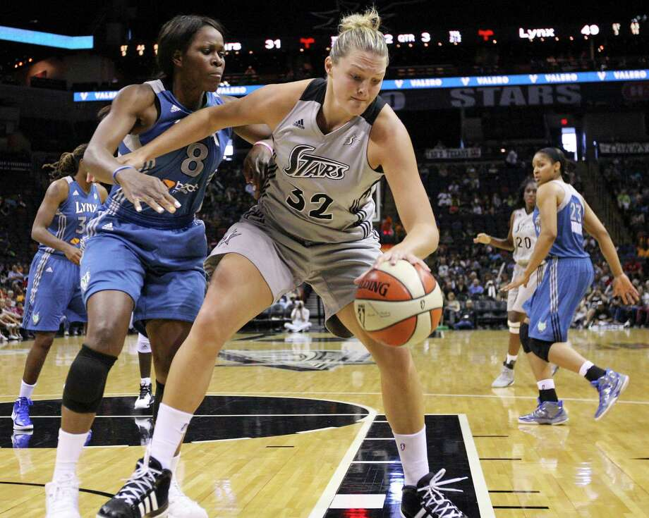 Silver Stars' Jayne Appel looks for room around Lynx's Taj McWilliams-Franklin during second half action Sunday Sept. 9, 2012 at the AT&T Center.  The Lynx won 81-62. Photo: Edward A. Ornelas, Express-News / © 2012 San Antonio Express-News