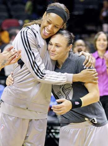 Silver Stars' Tangela Smith (left) hugs teammate Silver Stars' Tully Bevilaqua as she is honored before the game with the Lynx Sunday Sept. 9, 2012 at the AT&T Center. Bevilaqua will retire after the 2012 season. Photo: Edward A. Ornelas, Express-News / © 2012 San Antonio Express-News