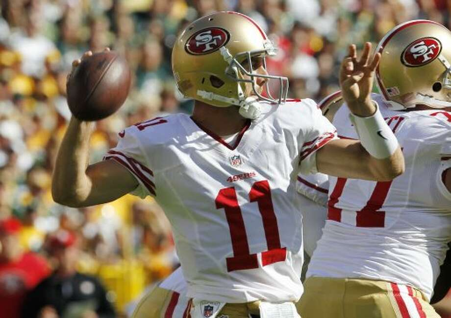 San Francisco 49ers' Alex Smith throws during the first half of an NFL football game against the Green Bay Packers Sunday, Sept. 9, 2012, in Green Bay, Wis.