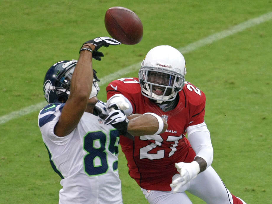 Arizona Cardinals defensive back Michael Adams (27) breaks up a pass intended for Seattle Seahawks wide receiver Doug Baldwin (89) during the first half of an NFL football game, Sunday, Sept. 9, 2012,in Glendale, Ariz. Photo: AP