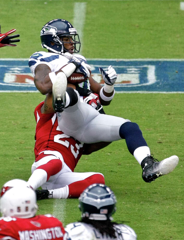 Seattle Seahawks wide receiver Braylon Edwards (17) pulls in a pass as Arizona Cardinals' William Gay (23) defends during the first half of an NFL football game, Sunday, Sept. 9, 2012,in Glendale, Ariz. Photo: AP