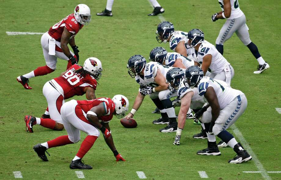 The Arizona Cardinals and the Seattle Seahawks line up during the first half of an NFL football game, Sunday, Sept. 9, 2012,in Glendale, Ariz. Photo: AP