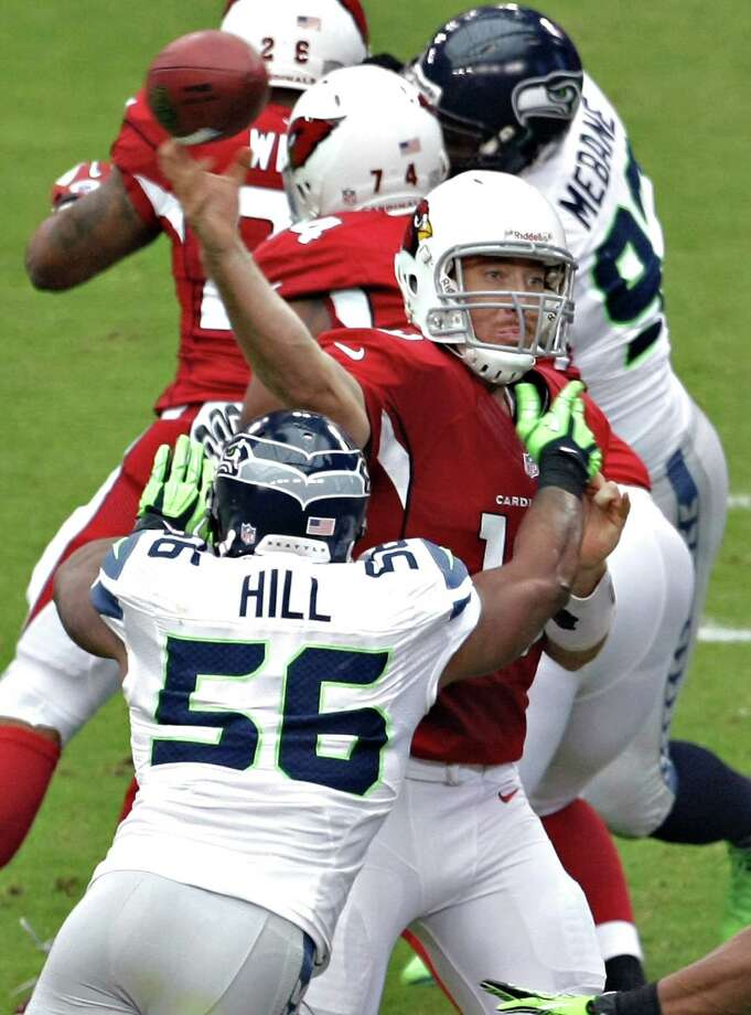 Arizona Cardinals quarterback John Skelton (19) throws under pressure from Seattle Seahawks linebacker Leroy Hill (56) during the first half of an NFL football game, Sunday, Sept. 9, 2012, in Glendale, Ariz. Photo: AP