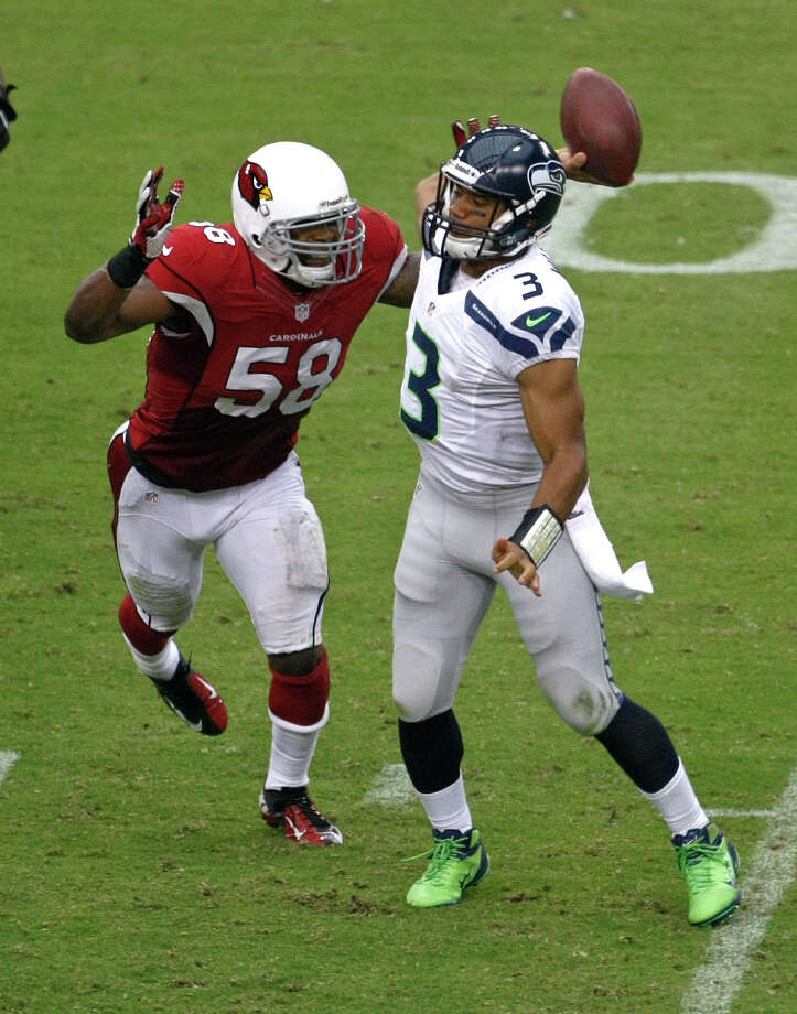 Seattle Seahawks quarterback Russell Wilson (3) throws under pressure from Arizona Cardinals linebacker Daryl Washington (58) during the first half of an NFL football game, Sunday, Sept. 9, 2012,in Glendale, Ariz. Photo: AP