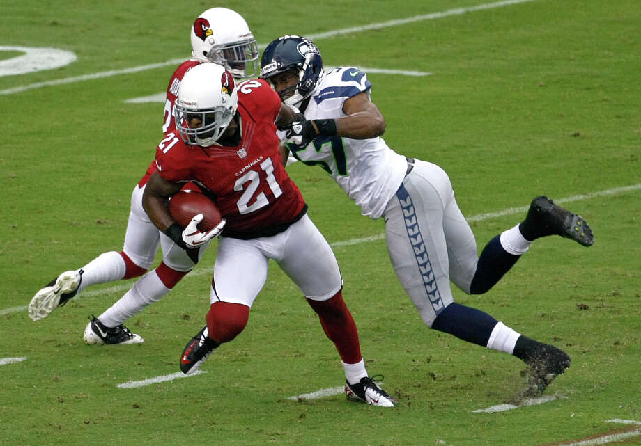 Arizona Cardinals cornerback Patrick Peterson (21) escapes the reach of Seattle Seahawks linebacker Mike Morgan (57) during the first half of an NFL football game, Sunday, Sept. 9, 2012,in Glendale, Ariz. Photo: AP