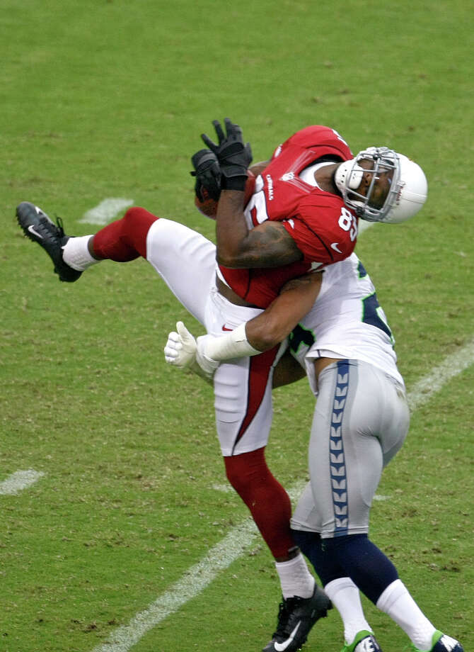 Arizona Cardinals wide receiver Early Doucet pulls in a pass against the Seattle Seahawks during the first half of an NFL football game, Sunday, Sept. 9, 2012,in Glendale, Ariz. Photo: AP