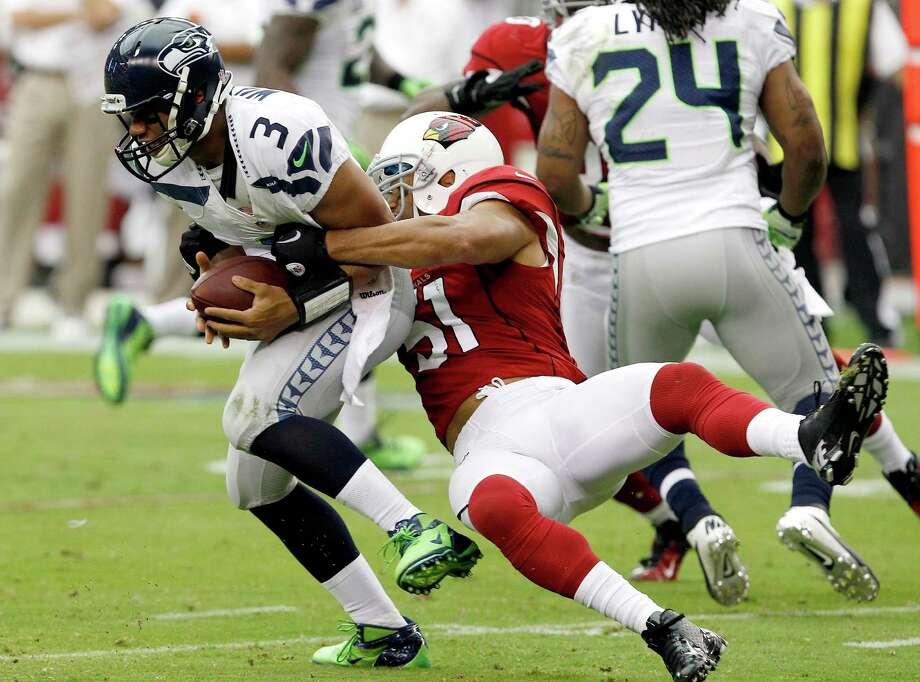 Seattle Seahawks' Russell Wilson (3) is sacked by Arizona Cardinals' Paris Lenon during the first half in an NFL football game on Sunday, Sept. 9, 2012, in Glendale, Ariz. Photo: AP