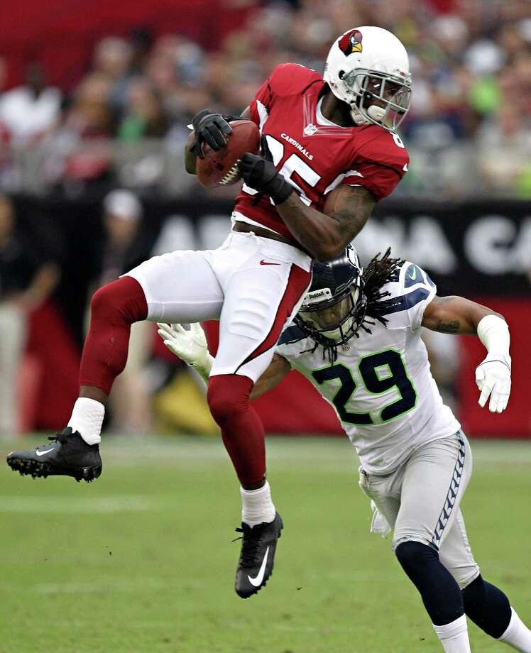 Arizona Cardinals wide receiver Early Doucet (85) pulls in a pass as Seattle Seahawks free safety Earl Thomas (29) defends during the first half of an NFL football game on Sunday, Sept. 9, 2012, in Glendale, Ariz. Photo: AP