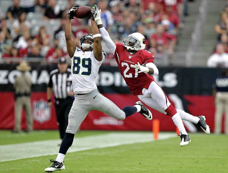 Seattle Seahawks wide receiver Doug Baldwin (89) cannot make the catch as Arizona Cardinals defensive back Michael Adams (27) defends during the first half of an NFL football game on Sunday, Sept. 9, 2012,in Glendale, Ariz. Photo: AP