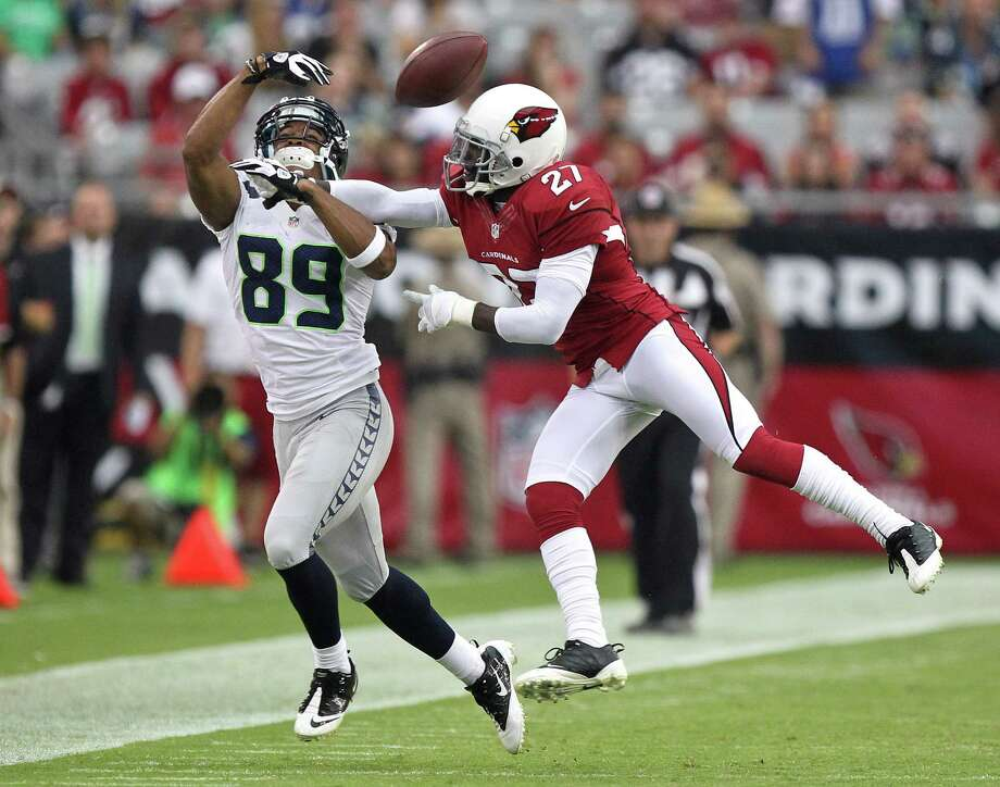 Seattle Seahawks wide receiver Doug Baldwin (89) can't make the catch as Arizona Cardinals defensive back Michael Adams (27) defends during the first half of an NFL football game, Sunday, Sept. 9, 2012,in Glendale, Ariz. Photo: AP