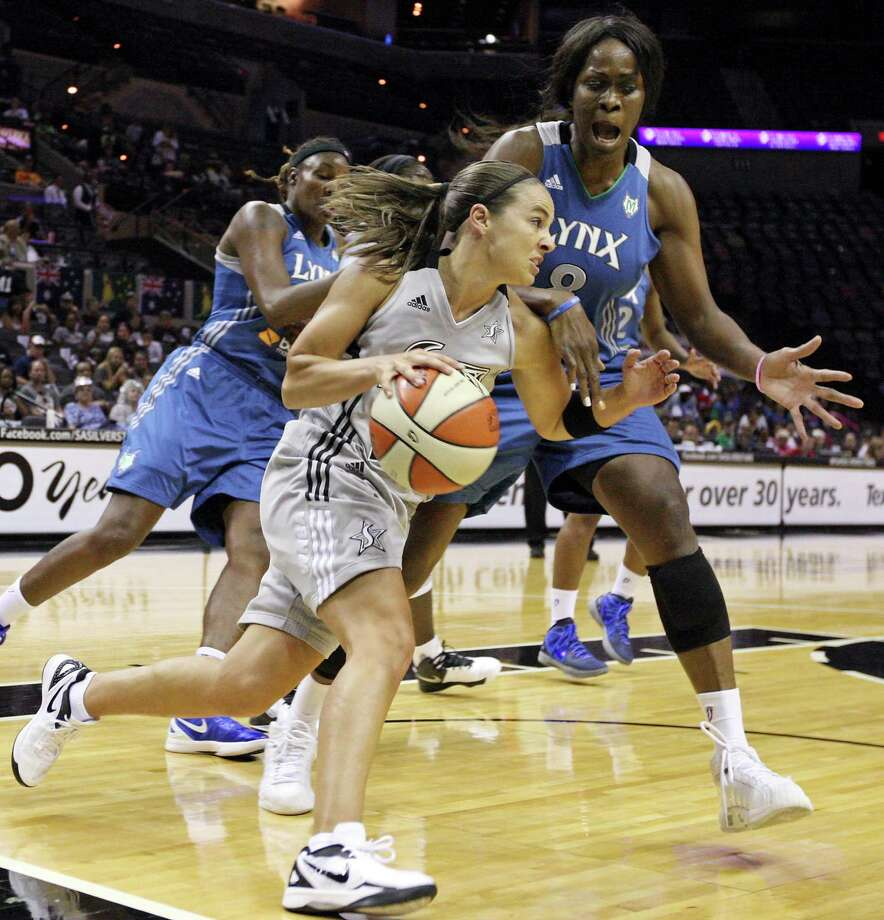 Silver Stars' Becky Hammon looks for room around Lynx's Taj McWilliams-Franklin during first half action Sunday Sept. 9, 2012 at the AT&T Center. Photo: Edward A. Ornelas, Express-News / © 2012 San Antonio Express-News