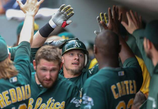 SEATTLE, WA - SEPTEMBER 09:  Josh Donaldson #20 of the Oakland Athletics is congratulated by teammates after hitting a home run in the  ninth inning against the Seattle Mariners at Safeco Field on September 9, 2012 in Seattle, Washington.  (Photo by Otto Greule Jr/Getty Images) Photo: Otto Greule Jr, Getty Images