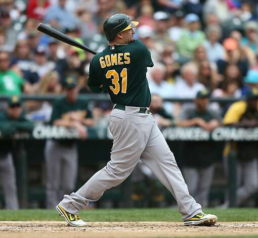 SEATTLE, WA - SEPTEMBER 09:  Jonny Gomes #31 of the Oakland Athletics hits a three-run homer in the fifth inning against the Seattle Mariners at Safeco Field on September 9, 2012 in Seattle, Washington.  (Photo by Otto Greule Jr/Getty Images) Photo: Otto Greule Jr, Getty Images