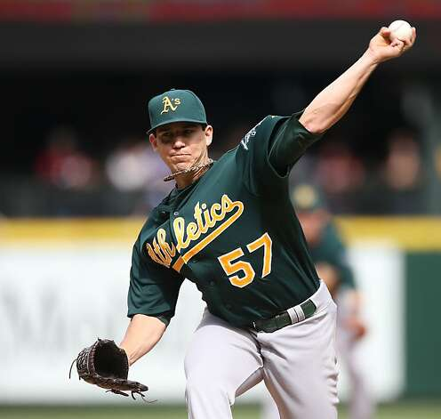 SEATTLE, WA - SEPTEMBER 09:  Starting pitcher Tom Milone #57 of the Oakland Athletics pitches against the Seattle Mariners at Safeco Field on September 9, 2012 in Seattle, Washington.  (Photo by Otto Greule Jr/Getty Images) Photo: Otto Greule Jr, Getty Images