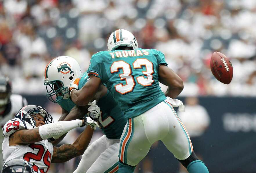 A fumble bounces away from Miami Dolphins running back Daniel Thomas (33) during the second quarter.