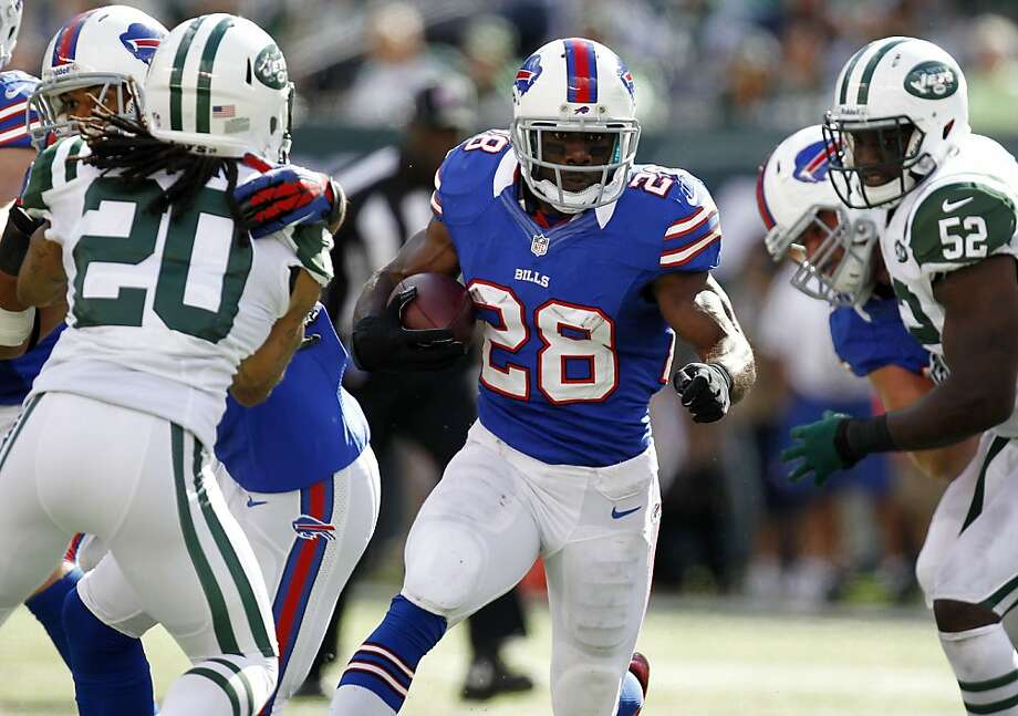 EAST RUTHERFORD, NJ - SEPTEMBER 09:   C.J. Spiller #28 of the Buffalo Bills runs against the New York Jets during their season opener at MetLife Stadium on September 9, 2012 in East Rutherford, New Jersey.  (Photo by Jeff Zelevansky/Getty Images) Photo: Jeff Zelevansky, Getty Images