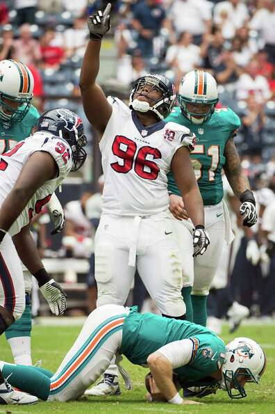 Houston Texans defensive end Tim Jamison celebrates after sacking Miami Dolphins quarterback Ryan Ta