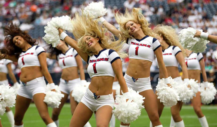 Houston Texans cheerleaders perform a routine before the Texans season opener against the Miami Dolphins at Reliant Stadium on Sunday, Sept. 9, 2012, in Houston. Photo: Brett Coomer, Houston Chronicle / © 2012  Houston Chronicle