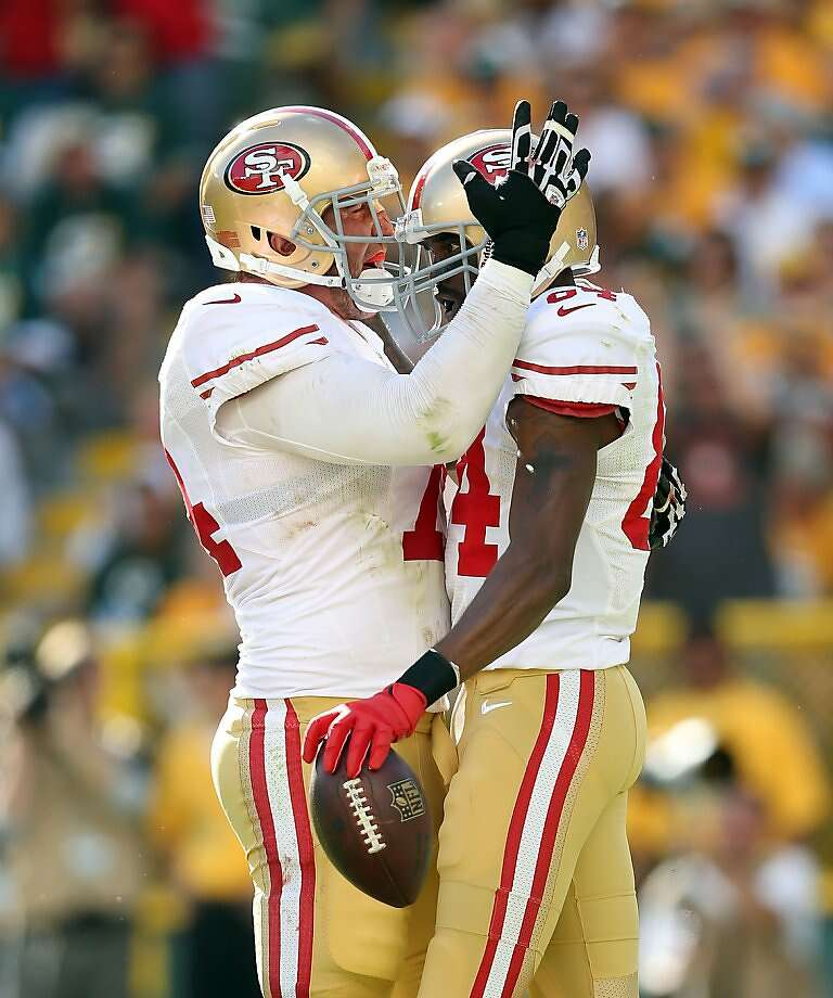 Tackle Joe Staley (left) and wide receiver Randy Moss celebrate after Moss' first touchdown catch for the 49ers. Photo: Andy Lyons, Getty Images
